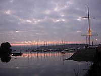 Kinsale aglow under marbled sky.